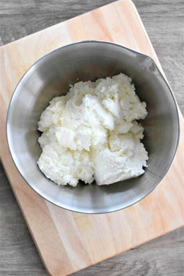 Ricotta cheese in a mixing bowl