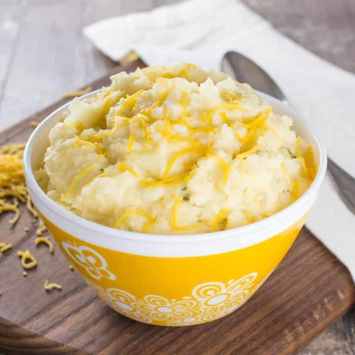 mashed potatoes in a yellow bowl with white flower design