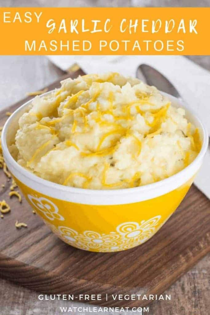 pin showing mashed potatoes in a yellow bowl with white flower designs on it
