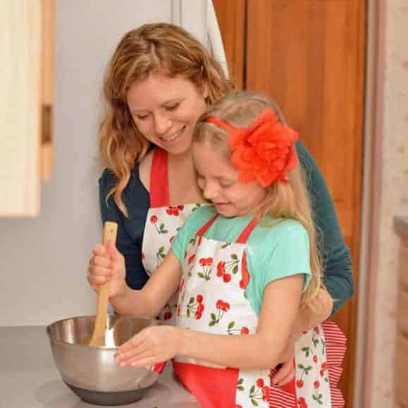 Sherri and her daughter, Londyn, mixing ingredients