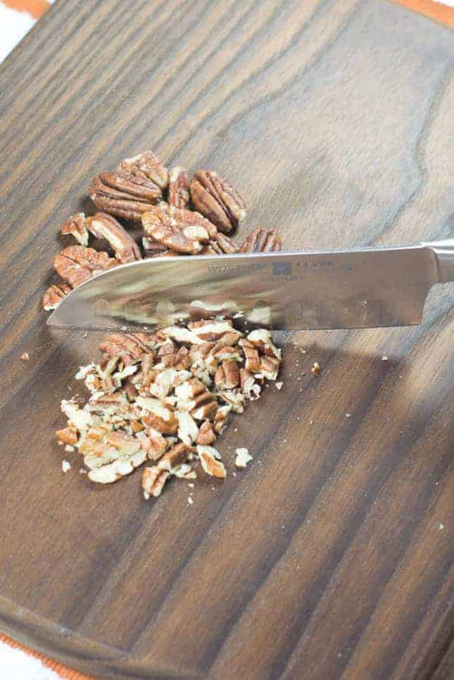 Chopping pecans on cutting board