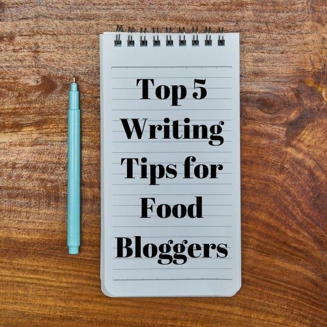 notepad with text saying top 5 writing tips for food bloggers and pen next to it