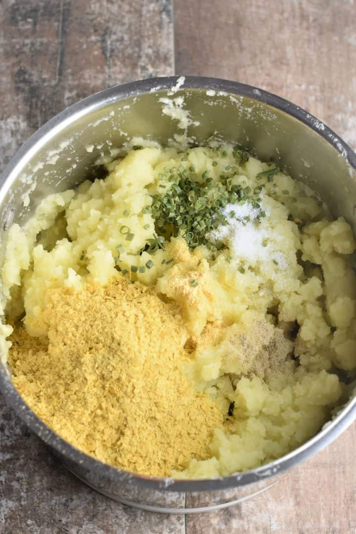 nutritional yeast, chives, salt and white pepper added to potatoes