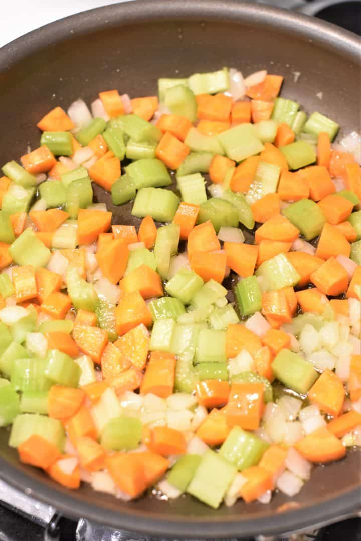 celery, carrots and onion cooking in non-stick pan