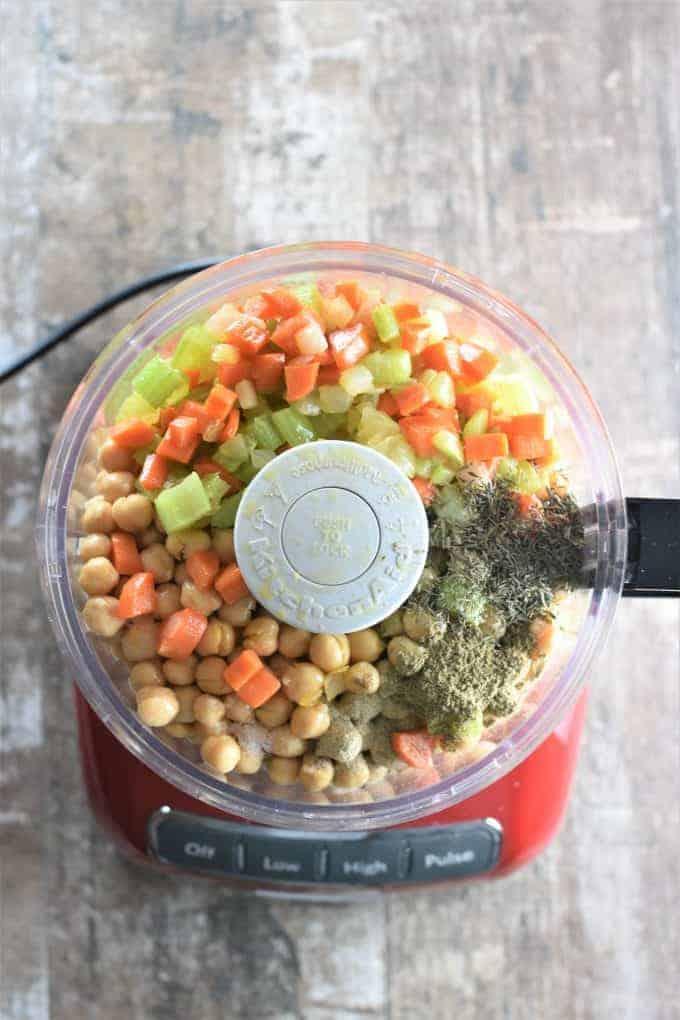 Chickpeas, veggie mixture and seasonings in a food processor