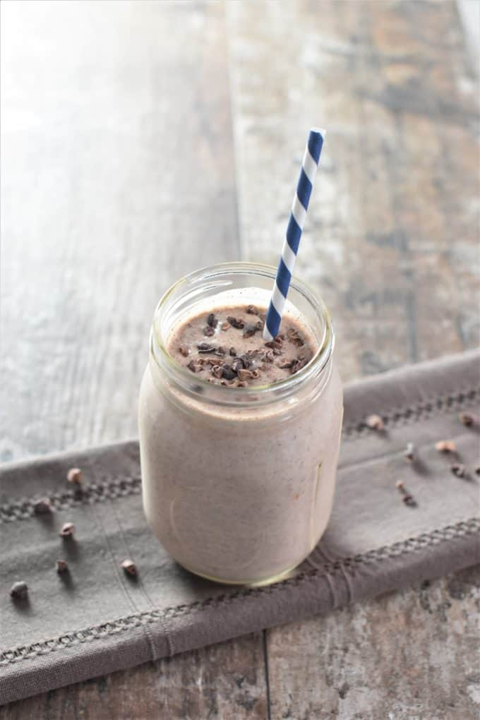 Banana Almond Butter Cacao Smoothie in a Jar with a Straw
