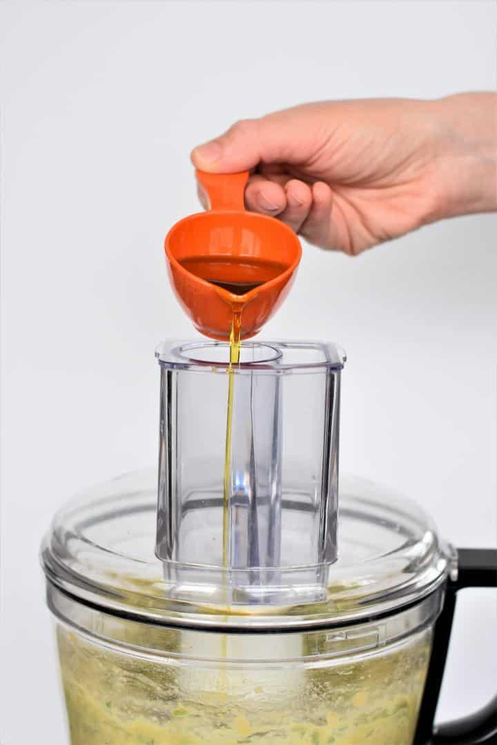 Adding oil to food processor