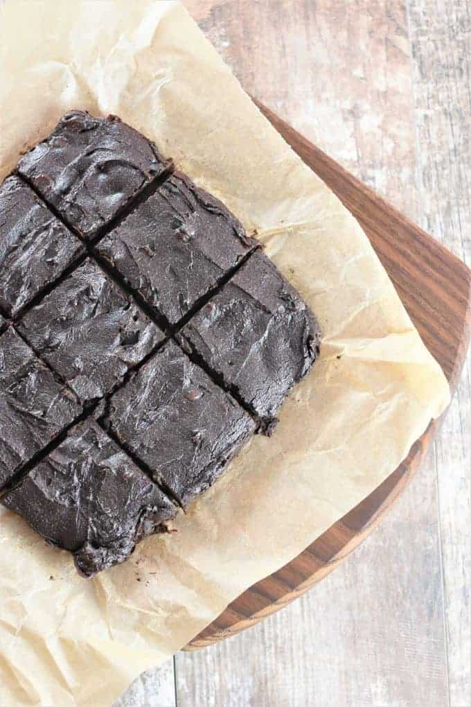 Cut Chickpea Flour Brownies on a Wood Board
