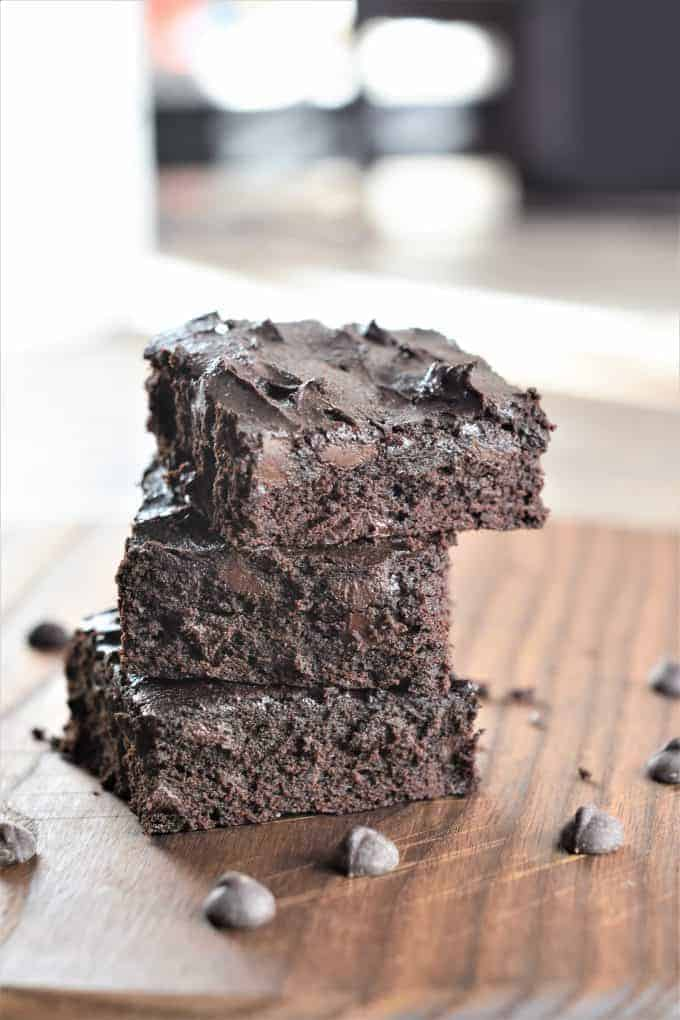 Stacked Chickpea Flour Brownies on a Wood Board