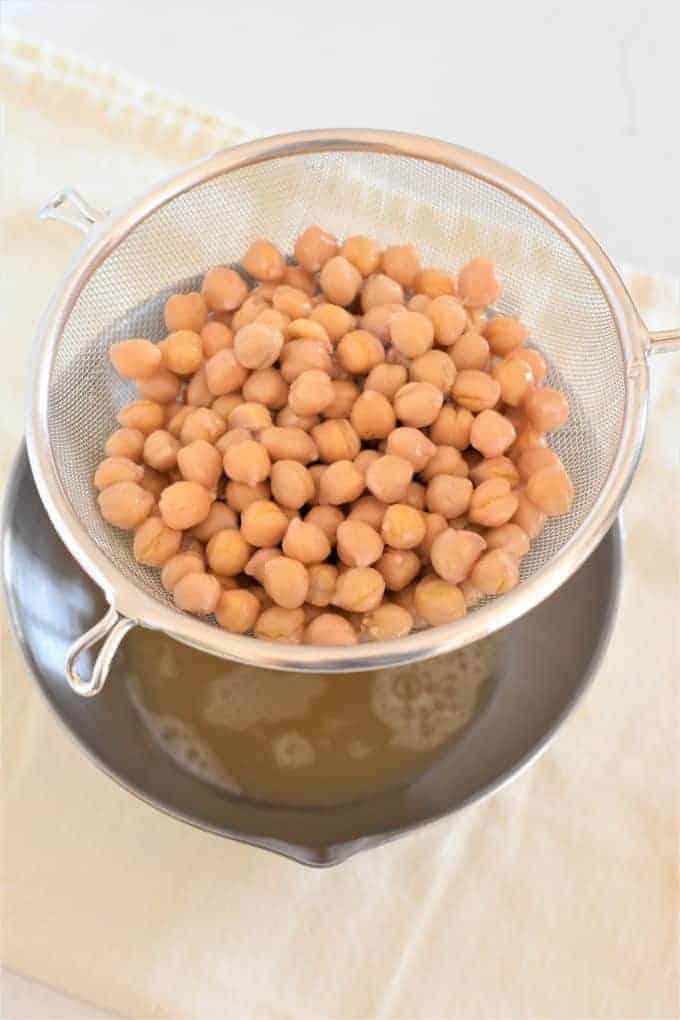 Straining chickpeas into a bowl