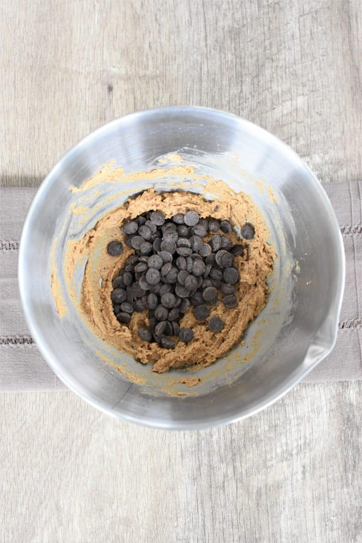 Chocolate chips added to the dough in the mixing bowl