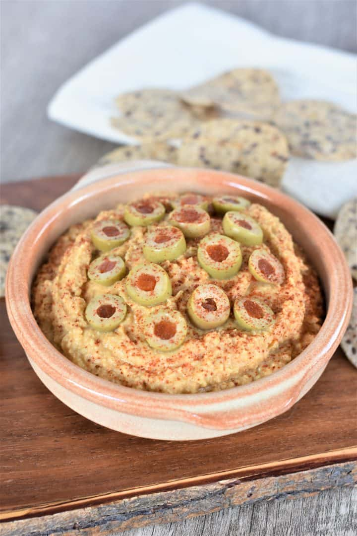 Green olive and pimento hummus in a bowl