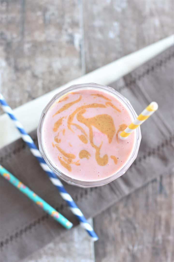 Strawberry smoothie with peanut butter swirl on top