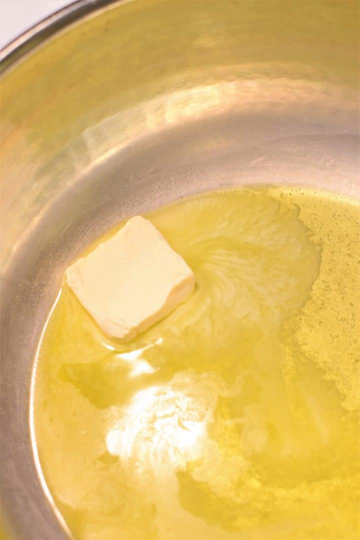 Butter melting in a pan with olive oil