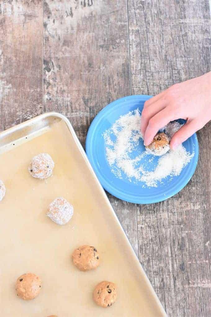 Rolling peanut butter balls in shredded coconut