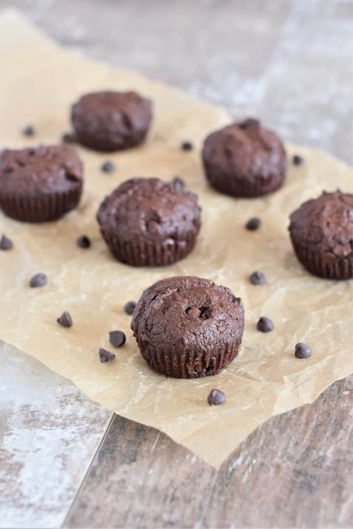 Brownie bites on parchment paper with chocolate chips