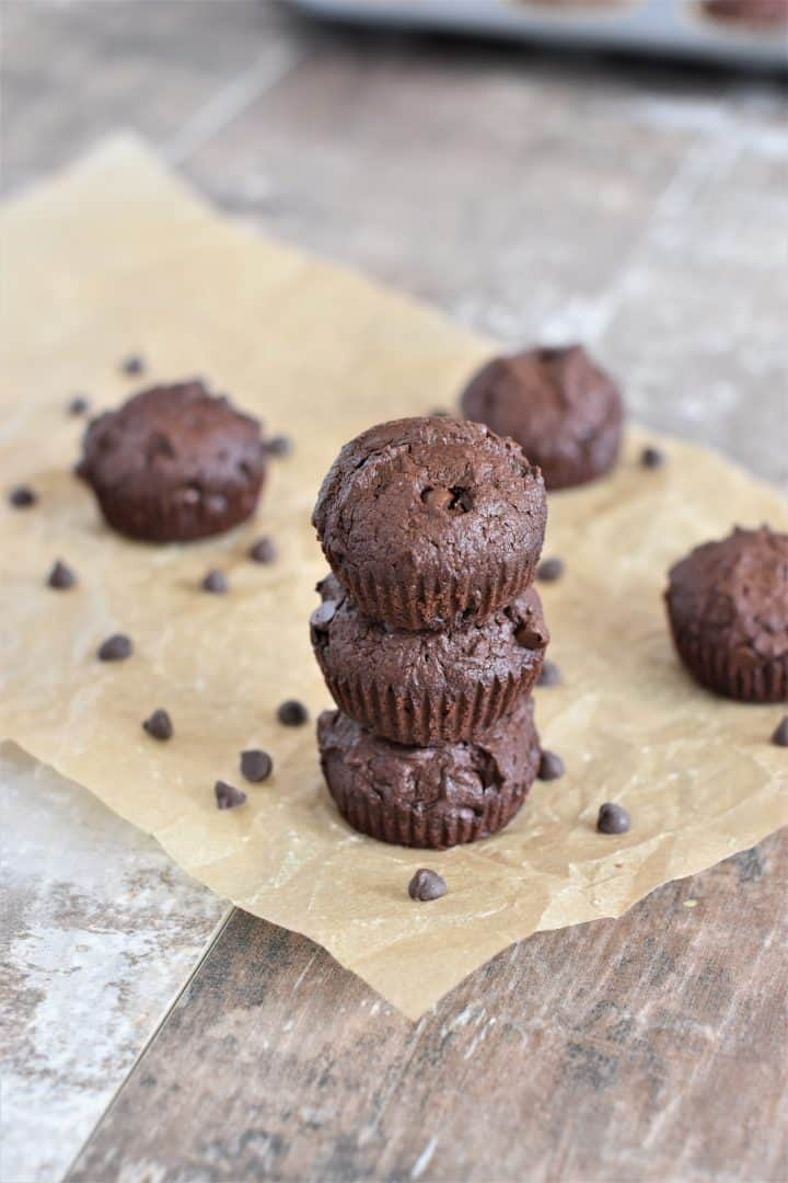 Brownie bites stacked on parchment paper