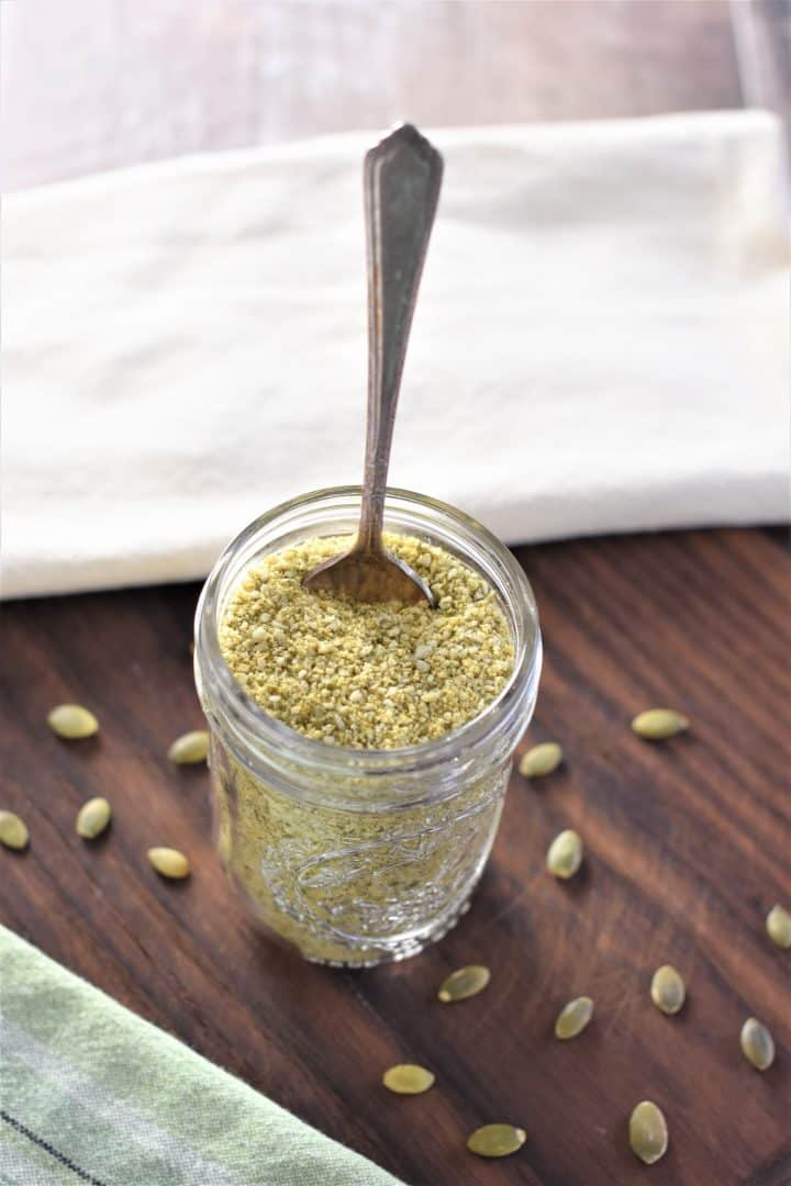 Vegan Parmesan Cheese in a glass jar with a spoon
