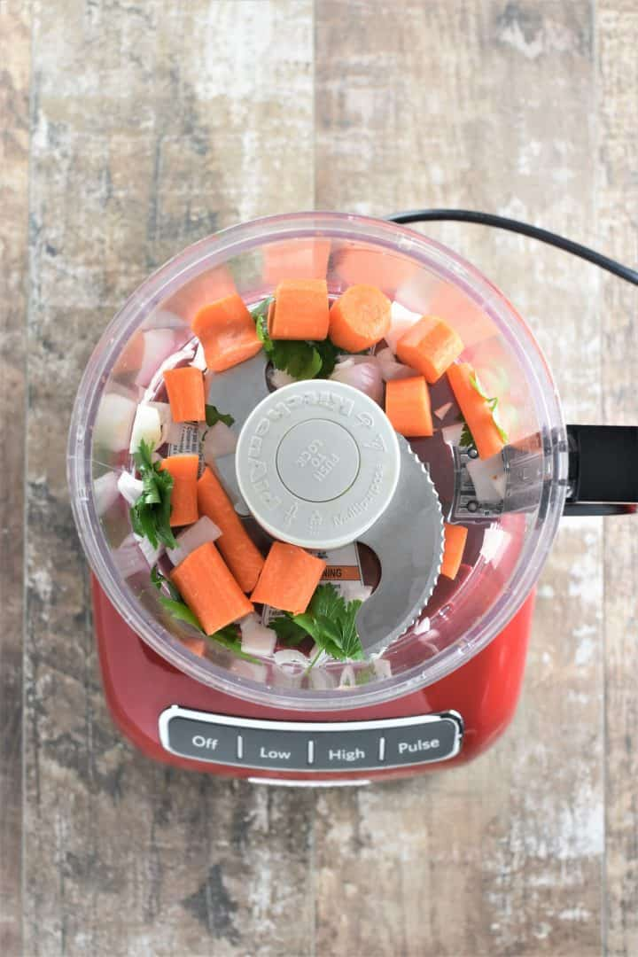 Carrots, shallot and parsley in a food processor