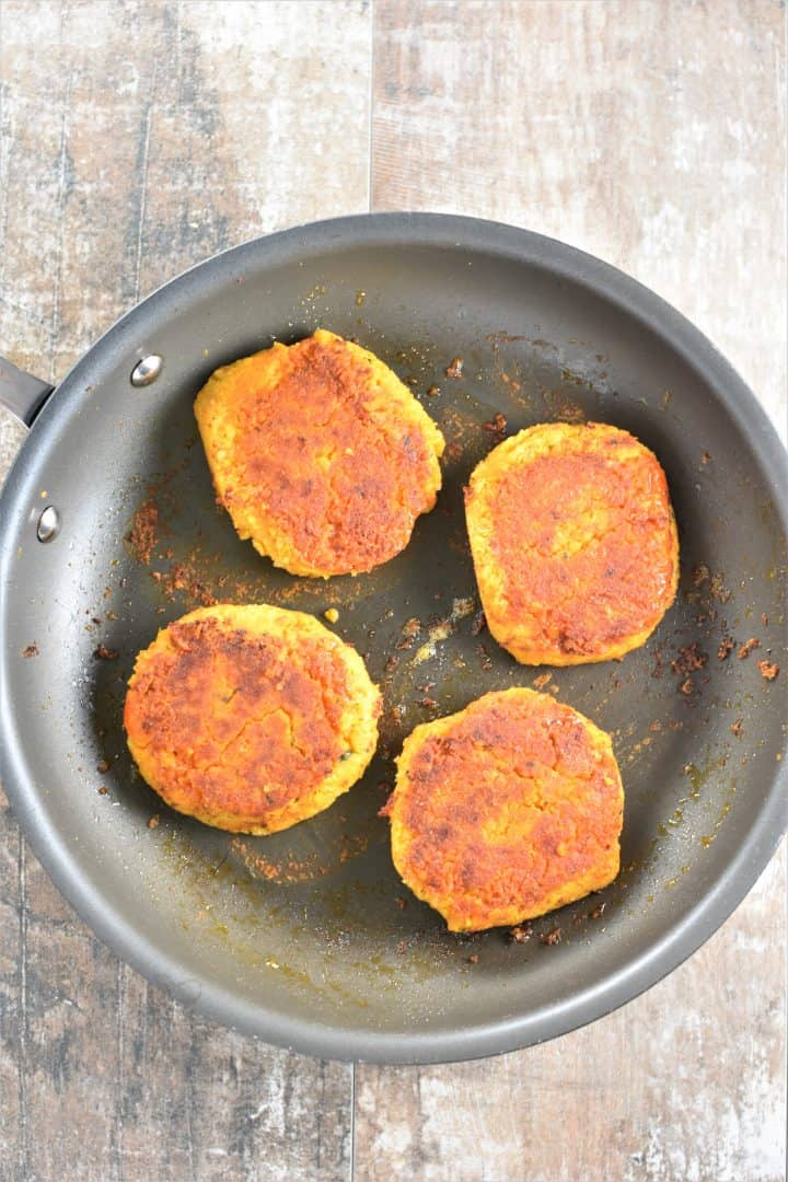 Buffalo Chickpea Burgers cooked in a pan