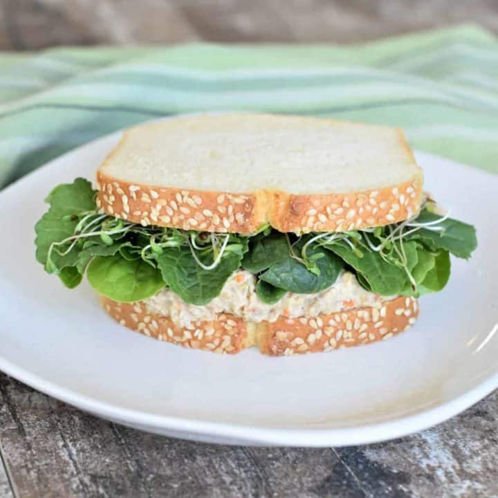 Chickpea salad sandwich on a white plate