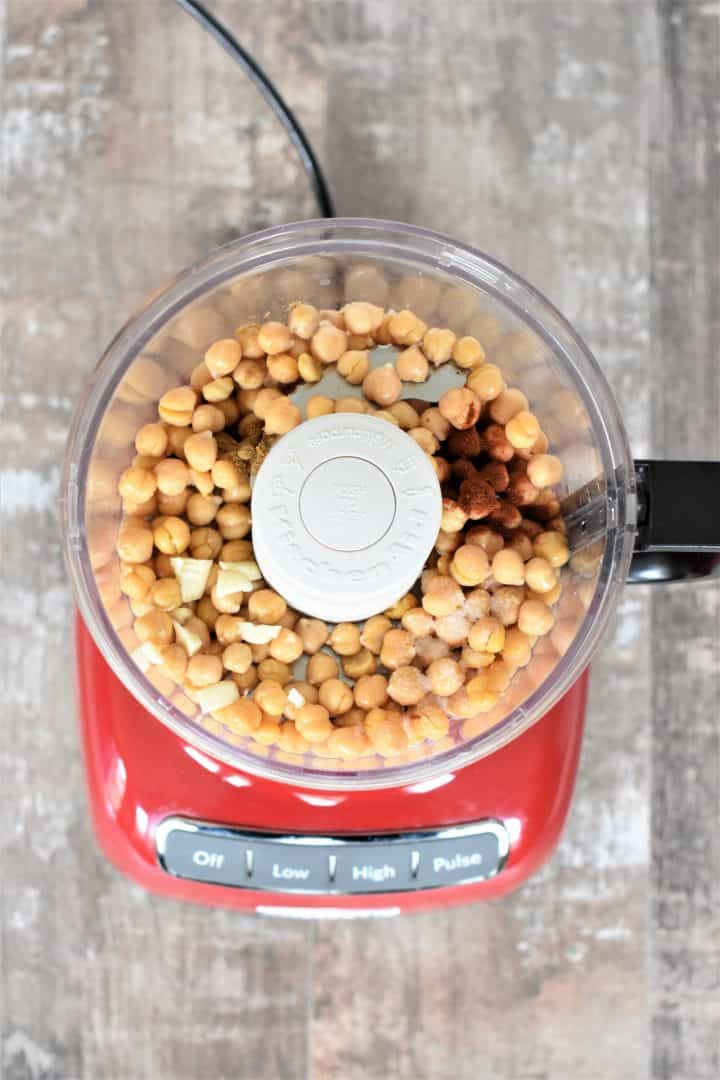 Chickpeas, garlic, cumin, paprika, salt and lemon juice in a food processor