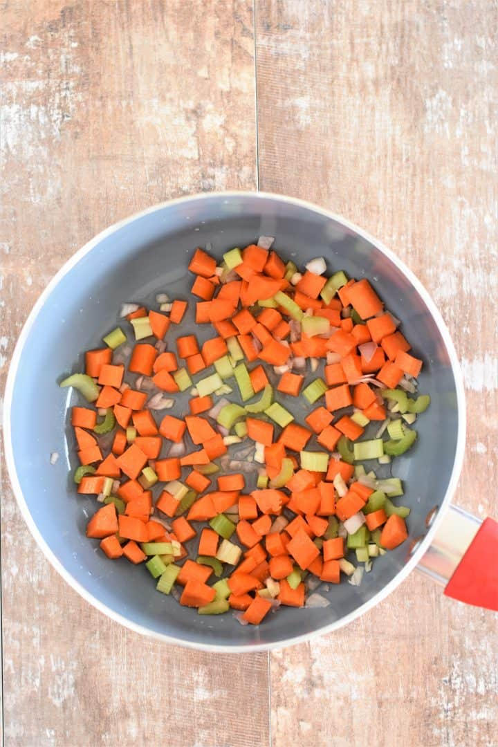 Carrots, celery, garlic and shallot cooking in wine