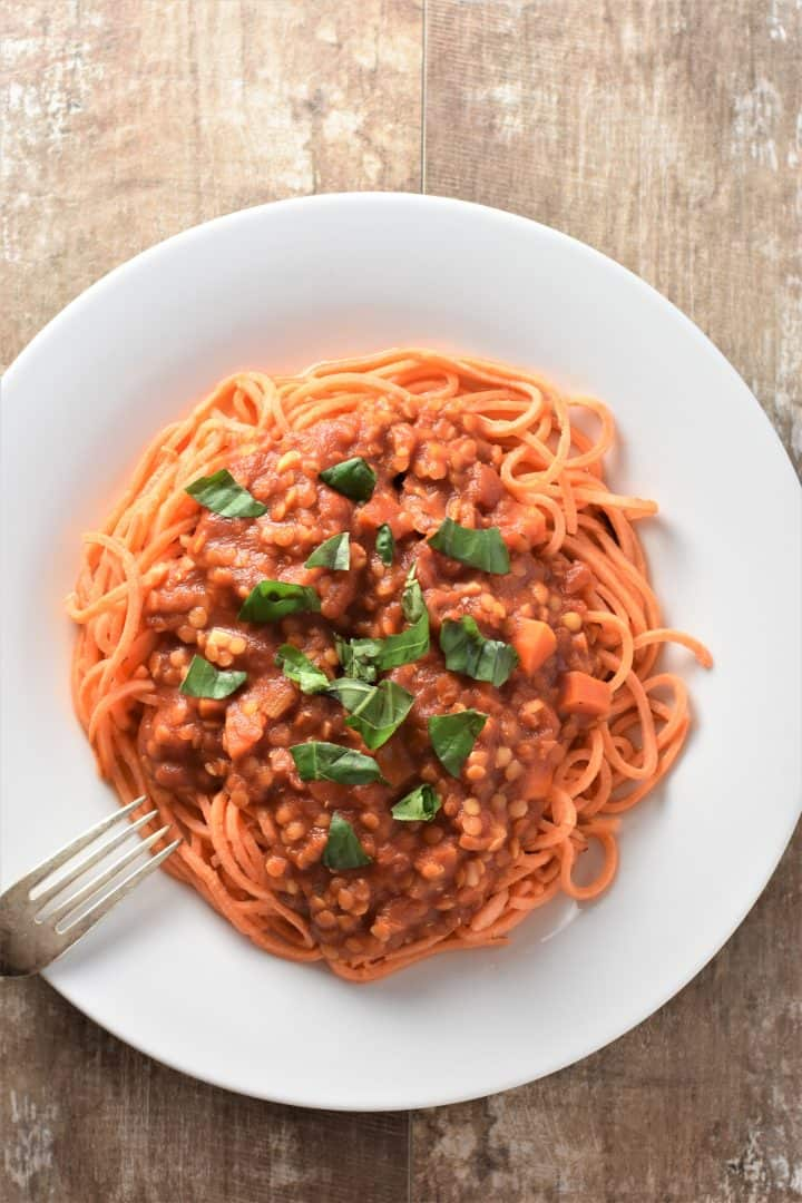 Sauce on sweet potato noodles with basil