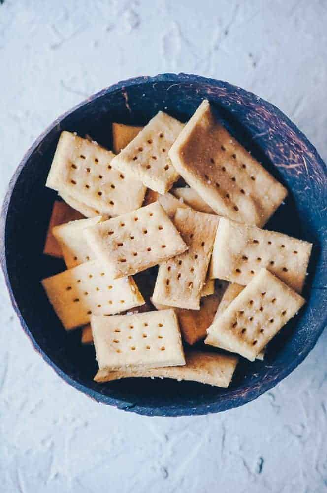 Chickpea crackers in a blue bowl