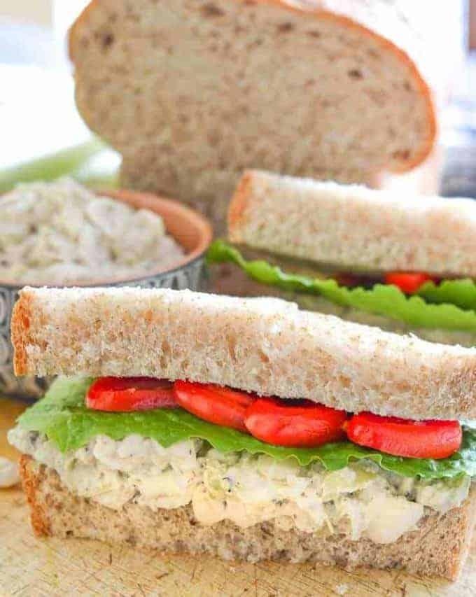 white bean sandwich open on a cutting board