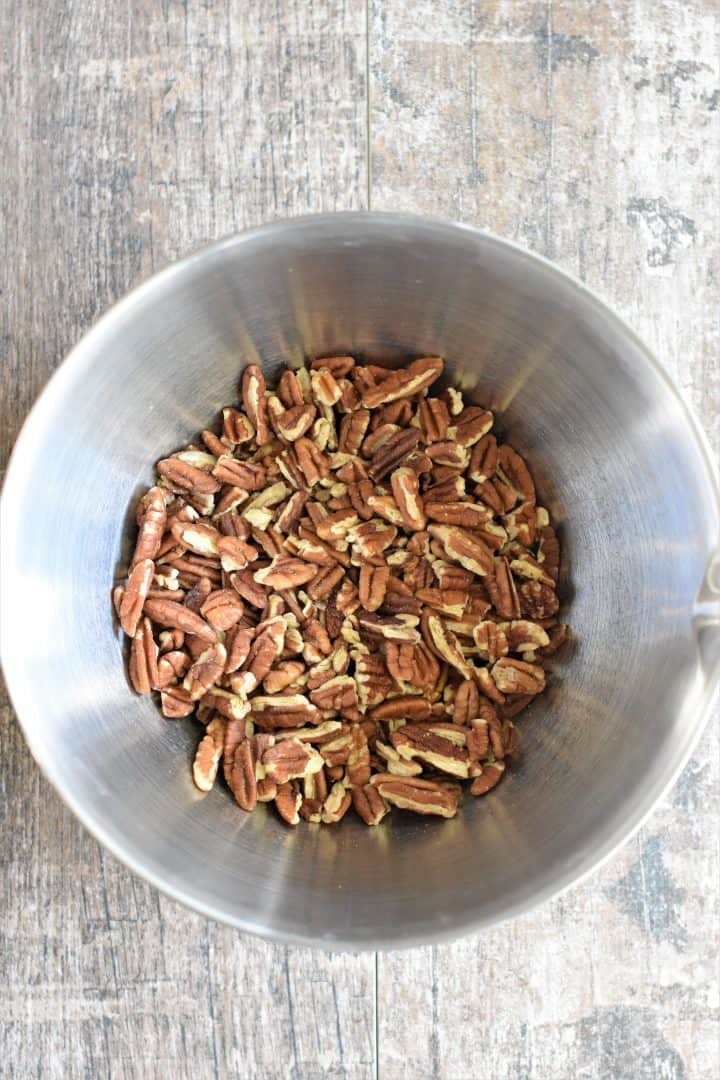 raw pecans in a mixing bowl