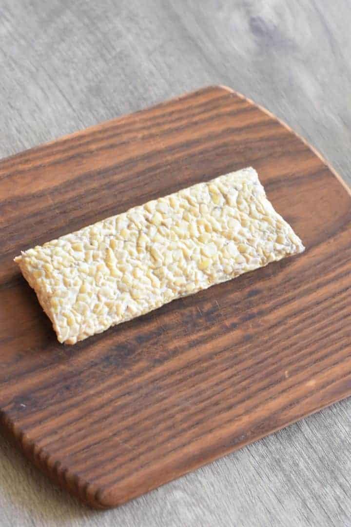 tempeh block on a cutting board