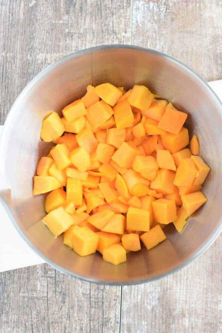 Butternut squash chunks in a mixing bowl