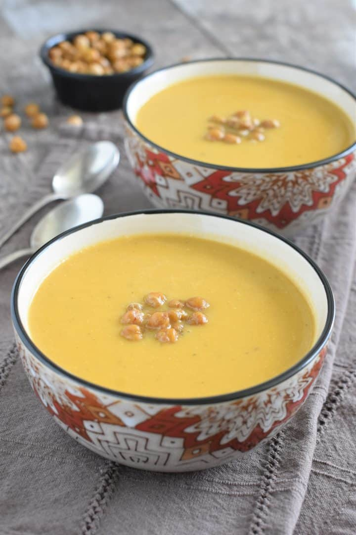 finished soup in two bowls topped with chickpeas