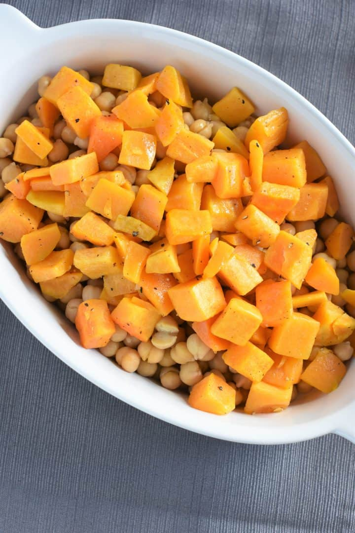 Chickpeas and cooked butternut squash in casserole dish