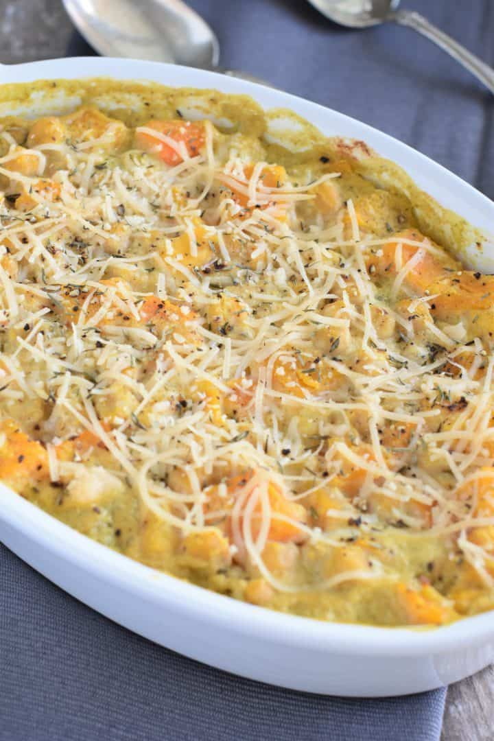 Baked casserole on napkin with two spoons in backgound