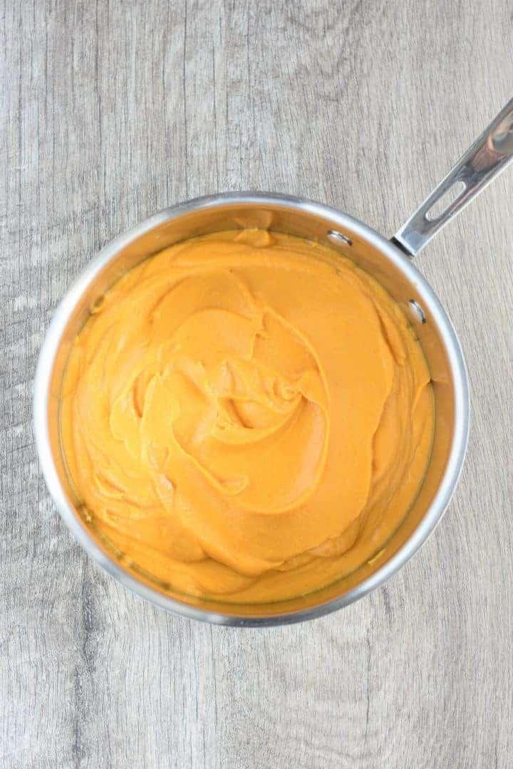 pumpkin sauce added to saucepan