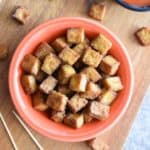 overhead of tofu in bowl on a wooden block