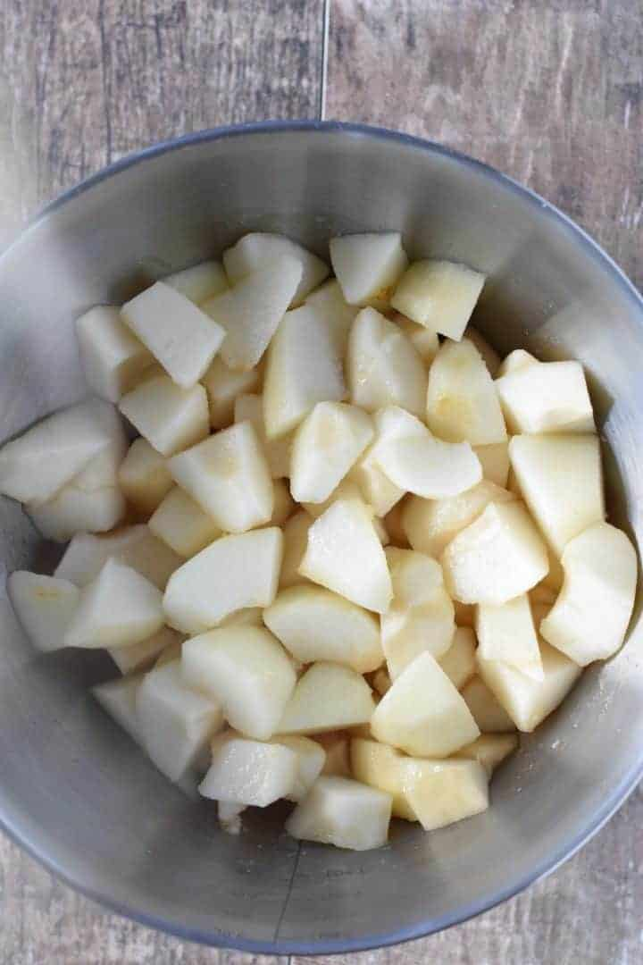 pear chunks in a mixing bowl