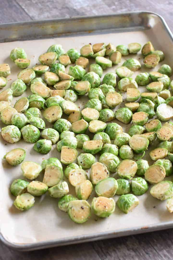 Brussels sprouts on baking sheet lined with parchment paper