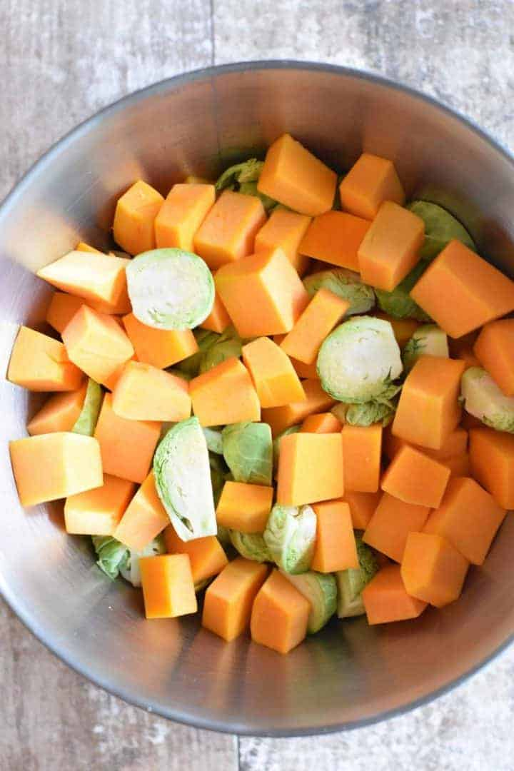 Butternut squash and Brussels sprouts in a mixing bowl