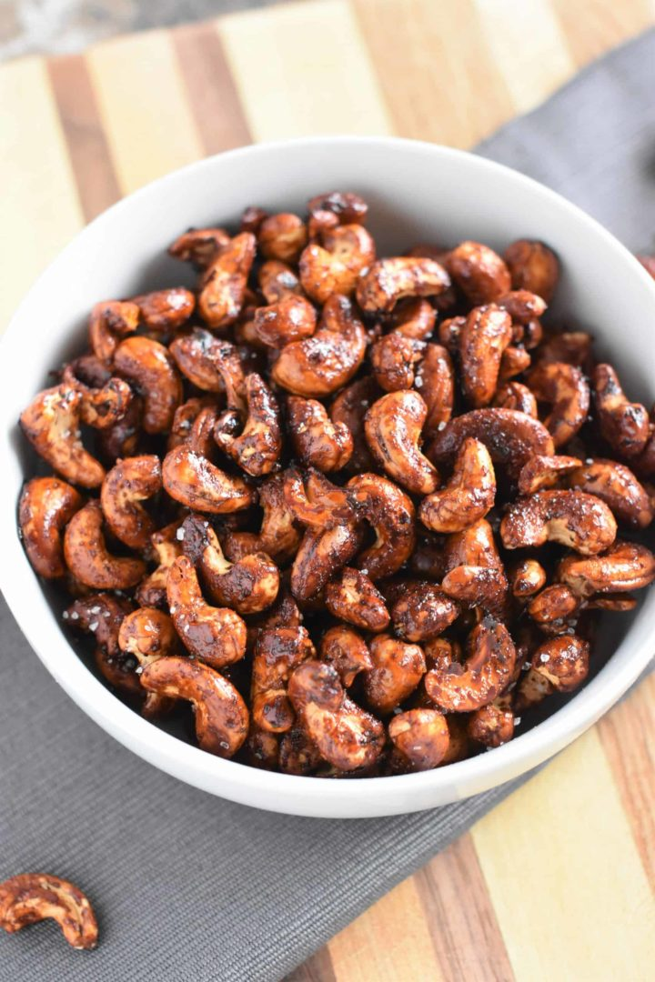 Sweet and Spicy Roasted Cashews in a white bowl