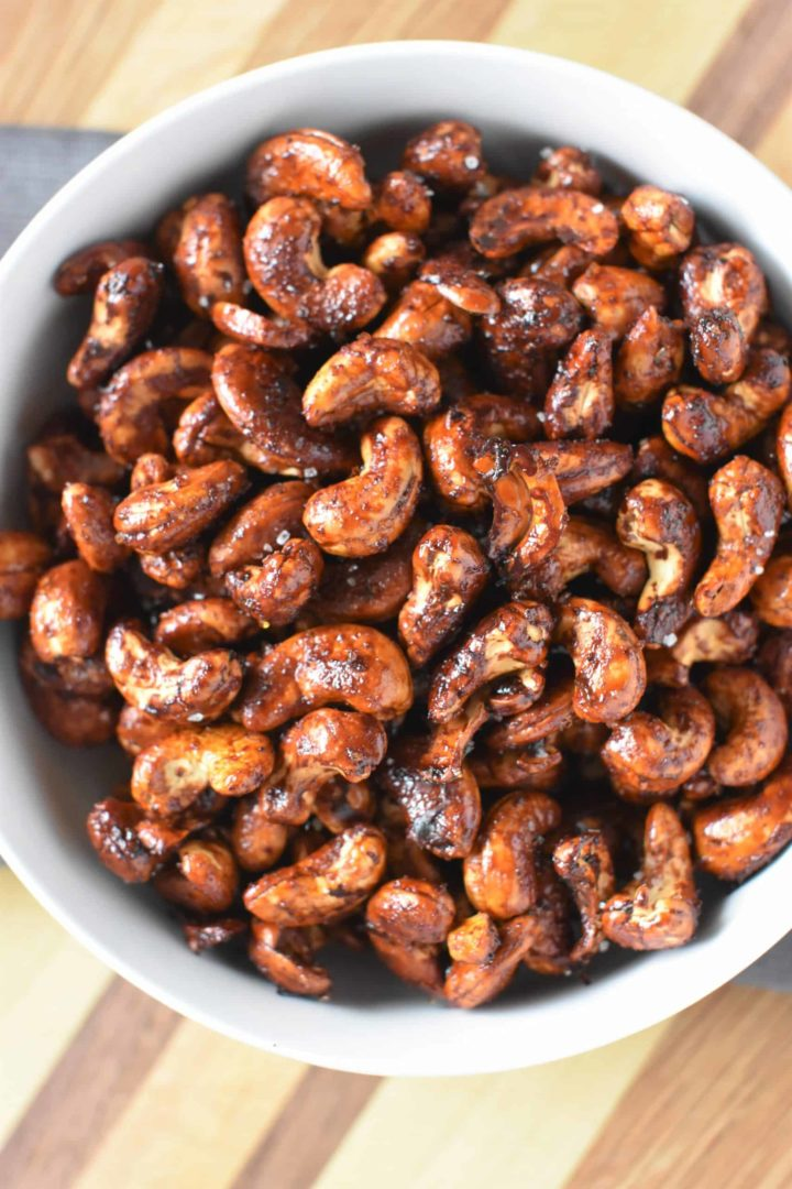 overhead shot of roasted nuts in a white bowl