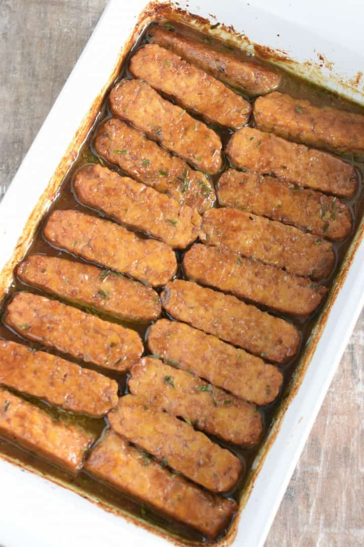 Baked tempeh strips in the baking dish