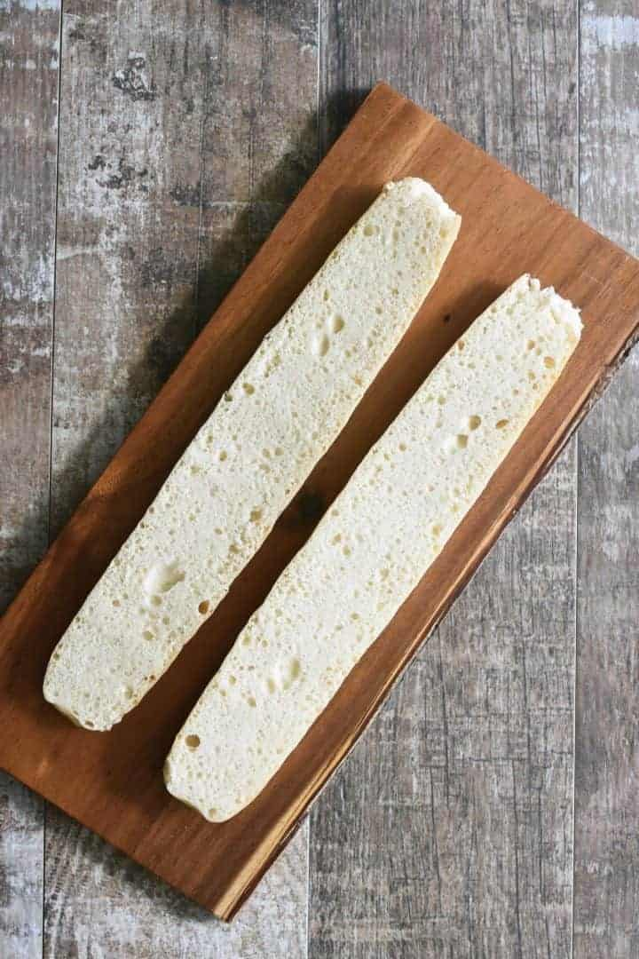 Gluten-Free baguette sliced horizontally on cutting board
