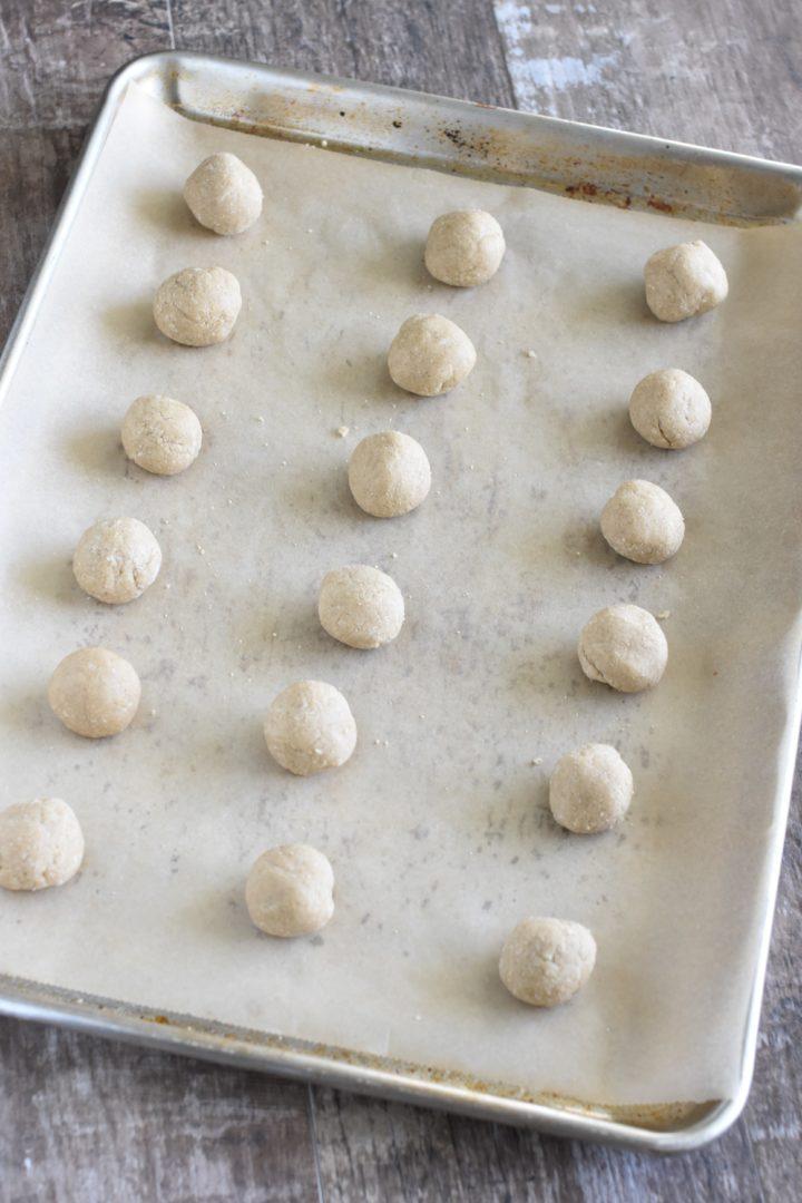 dough balls on parchment-lined baking sheet