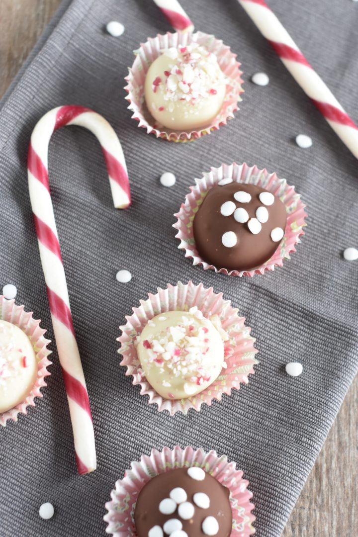 Truffles on a kitchen napkin with sequin sprinkles and candy canes around them