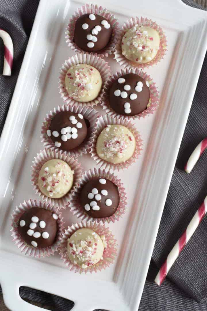 sugar cookie truffles on white serving platter alternating dark and white chocolate flavors