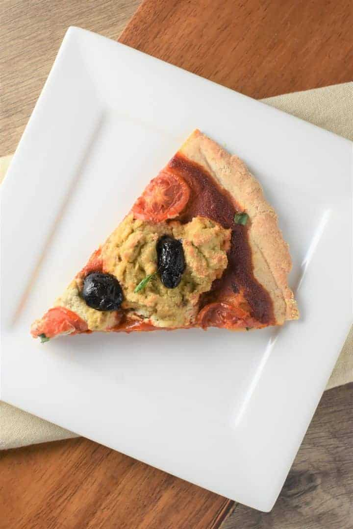 Slice of pizza with vegan ricotta cheese