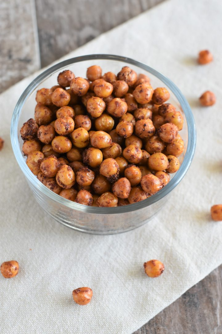 BBQ chickpeas in bowl on kitchen towel with some on the towel